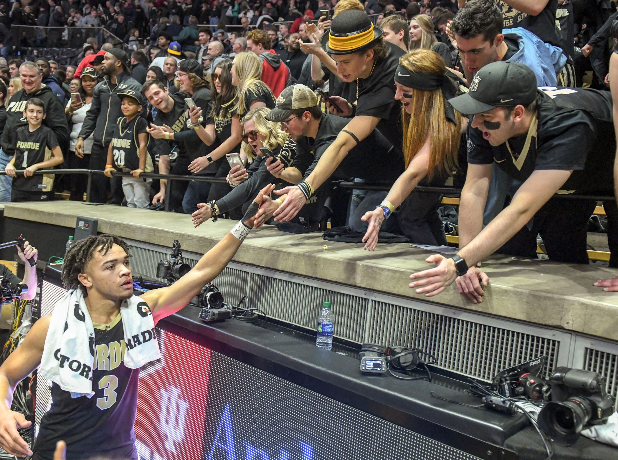 Purdue guard Carsen Edwards shakes hands with members of the Paint Crew following a 70-55 victory over Indiana
