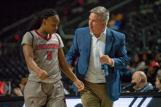 UL's head coach Garry Brodhead talks to Jomyra Mathis on the sideline as the Ragin' Cajuns take on the UL Monroe Warhawks at the Cajundome on Saturday Jan. 19, 2019.