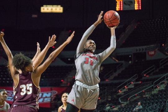 UL's Ty'Reona Doucet goes up to the goal to score as the Ragin' Cajuns take on the UL Monroe Warhawks at the Cajundome on Saturday Jan. 19, 2019.