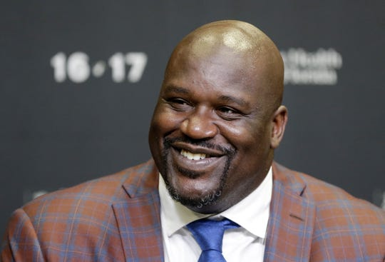 Retired Hall of Fame basketball player Shaquille O'Neal smiles as he talks to reporters during an NBA basketball news conference in Miami on Dec. 22, 2016.
