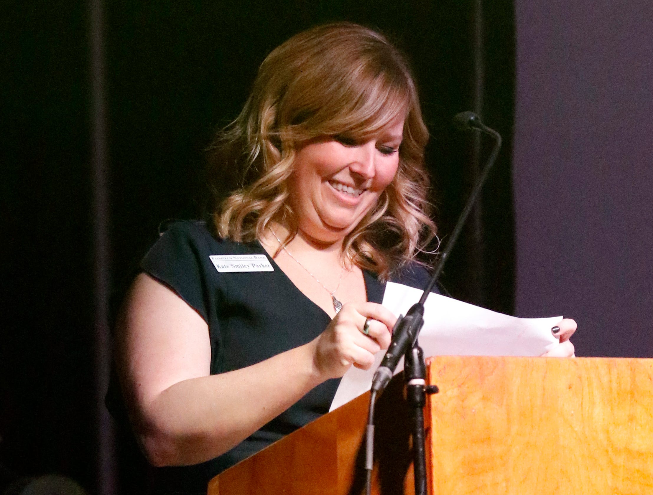 Kate Smiley Parker, Freedom Years Director for Fairfield National Bank, accepts the Tammy Nusser Community Service Award Saturday, Jan. 19, 2019, at the Lancaster Fairfield County Chamber of Commerce Awards Ceremony at Fisher Catholic High School in Lancaster.