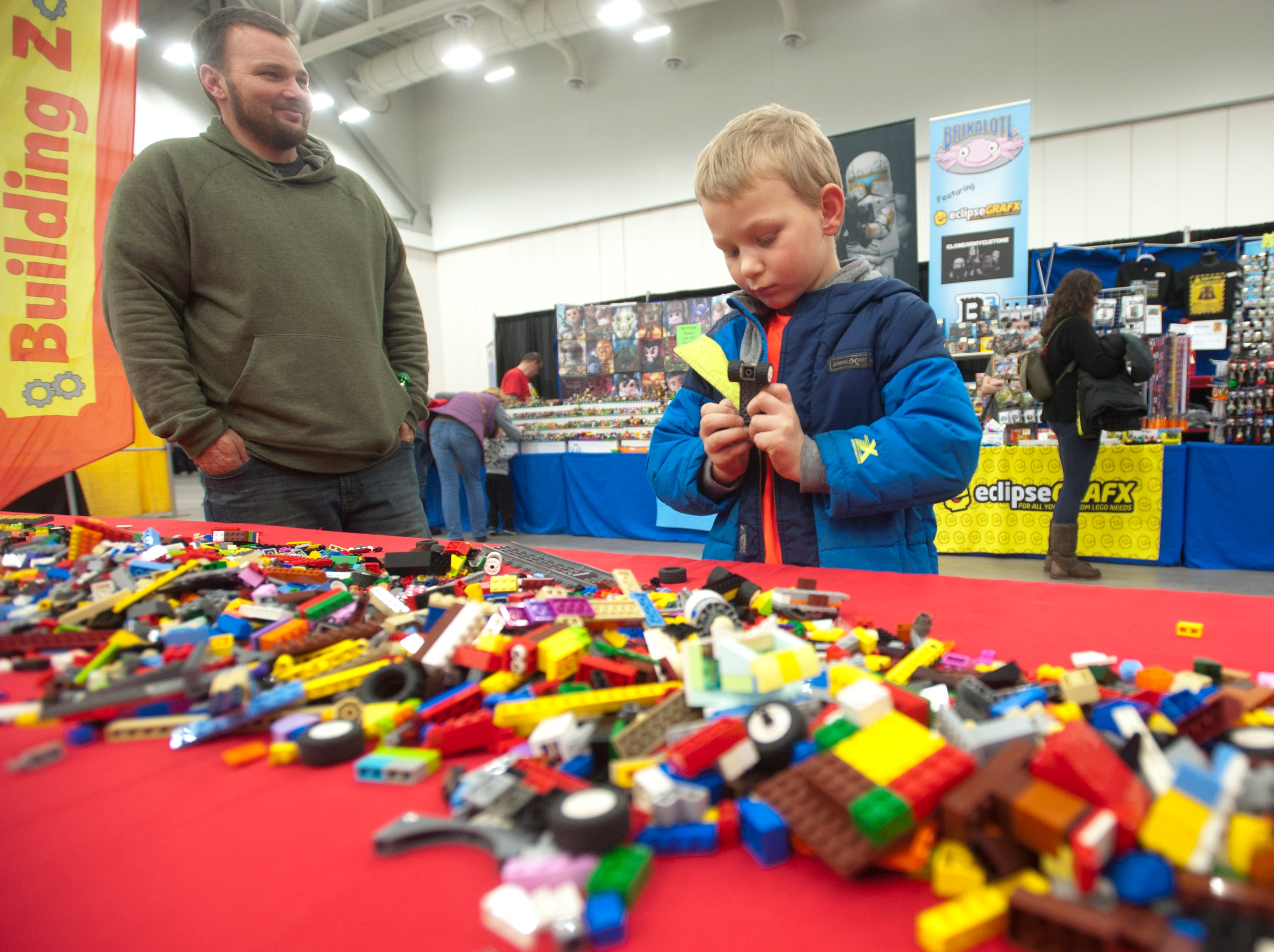 Dad Michael Branch of Crestwood watches his 6-yr-old son, Michael Jr. put together a project at the Lego Building Zone, part of the BrickUniverse Lego Fan Convention at the Kentucky International Convention Center in downtown Louisville.19 January 2019
