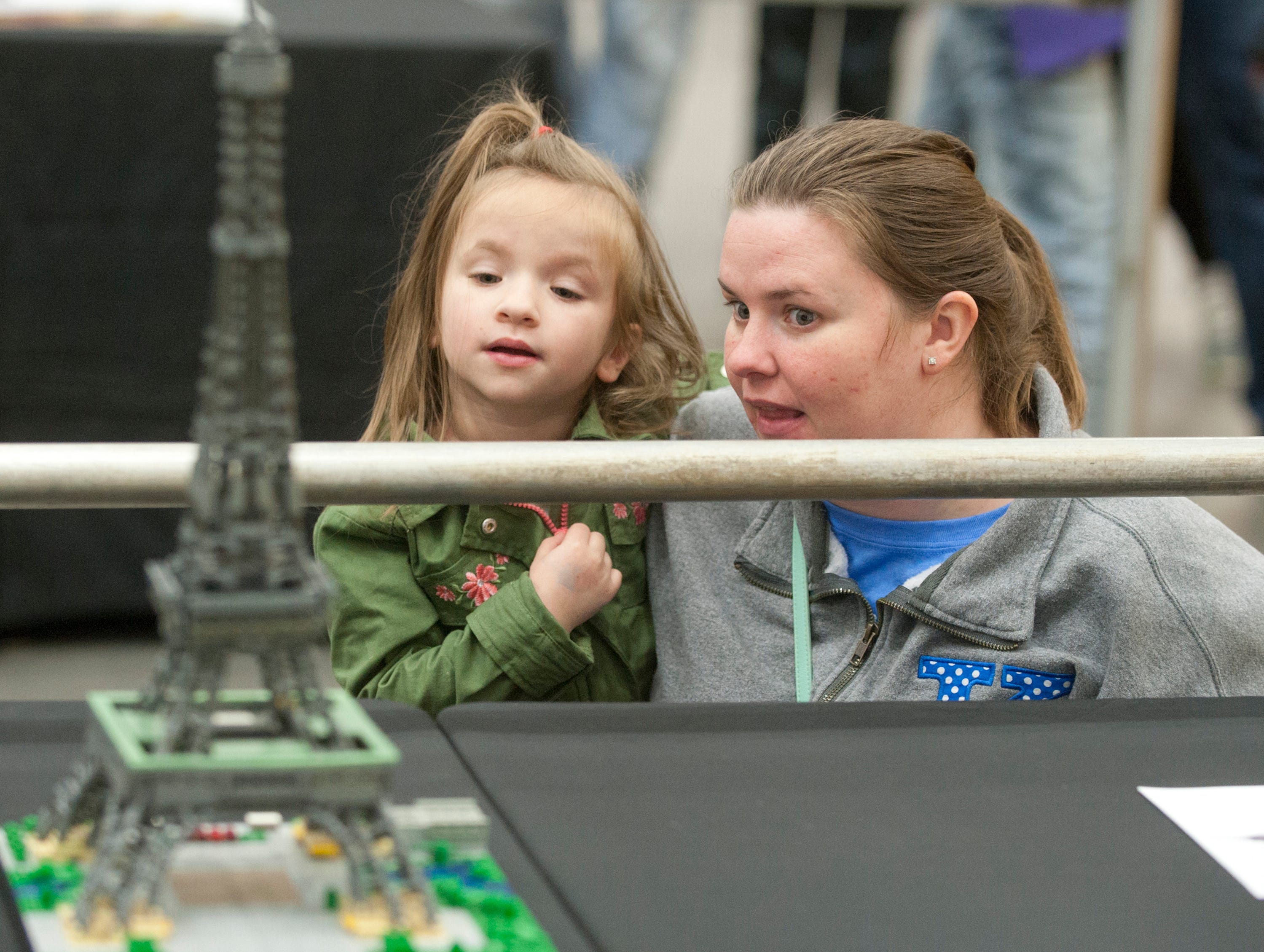 Looking at a Lego version of the Eiffel Tower i Sadie Ballard, age 5, and her mother, Randi of St. Matthews, Ky.  The exhibit was part of the BrickUniverse Lego Fan Convention at the Kentucky International Convention Center in downtown Louisville.19 January 2019