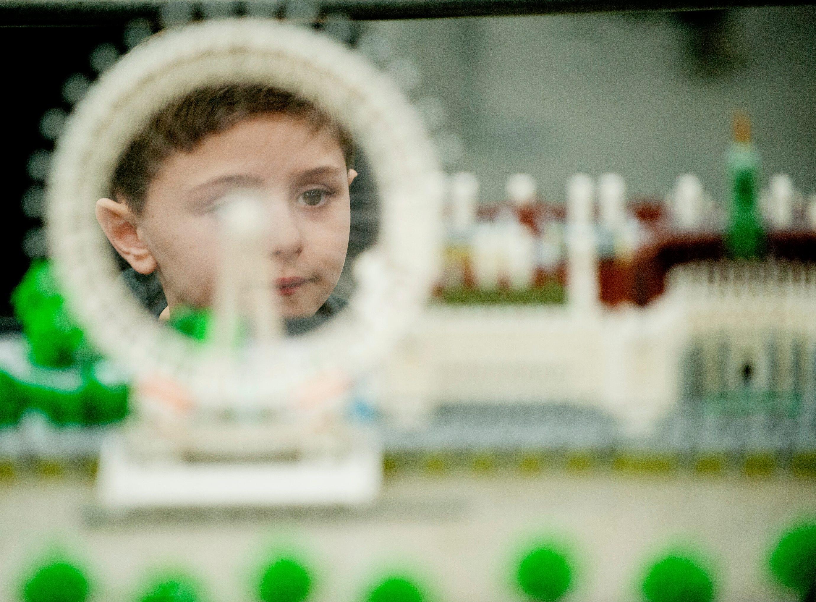 Corey Wwanson, age 8, of Jeffersontown, seen through a Lego representation of The London Eye, a cantilevered observation wheel on the South Bank of the River Thames in London. The exhibit was part of the BrickUniverse Lego Fan Convention at the Kentucky International Convention Center in downtown Louisville.19 January 2019