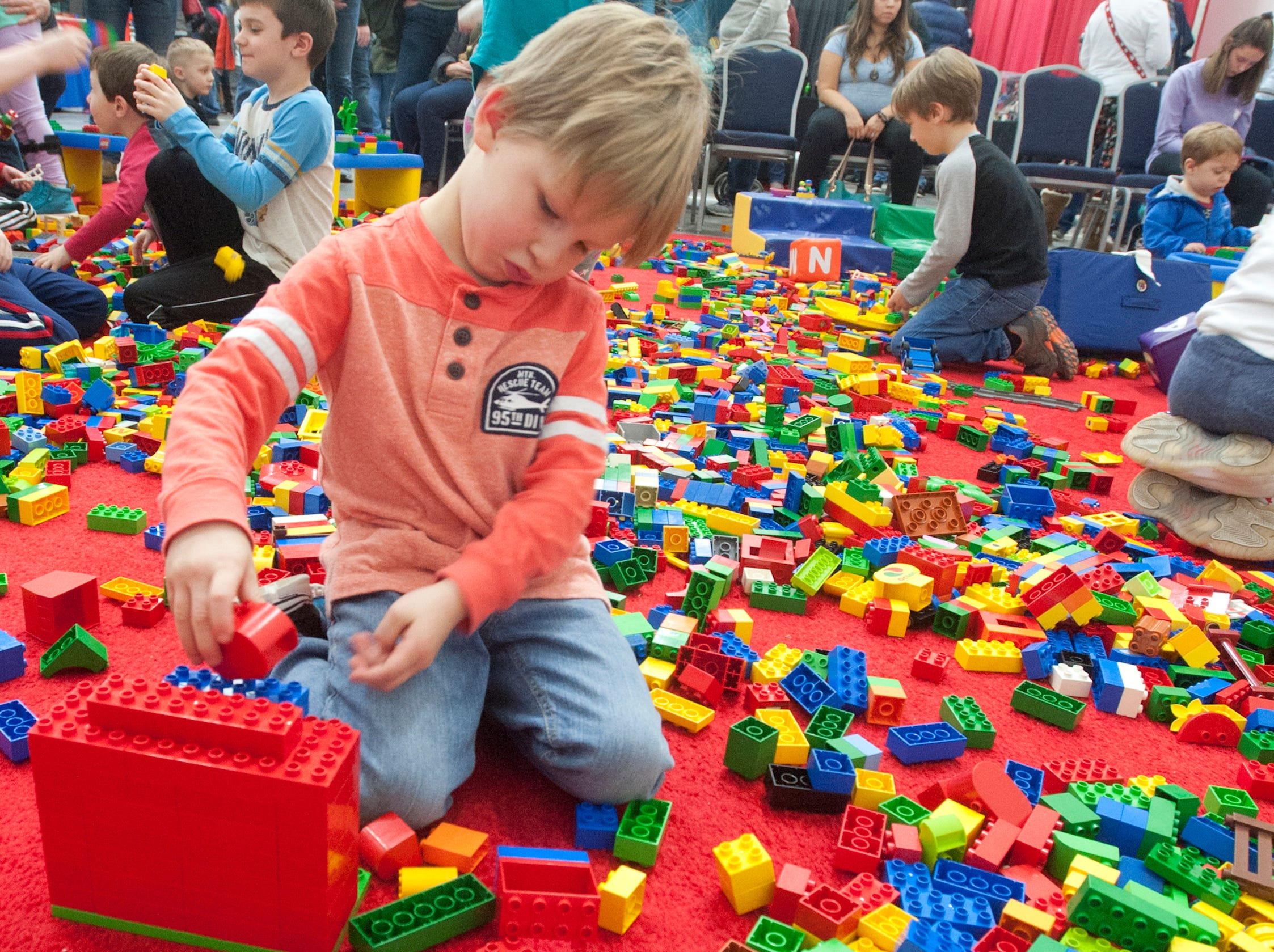 Grayson Bronk, age 4, of Jeffersonvile, plays with large Legos at the BrickUniverse Lego Fan Convention at the Kentucky International Convention Center in downtown Louisville.19 January 2019