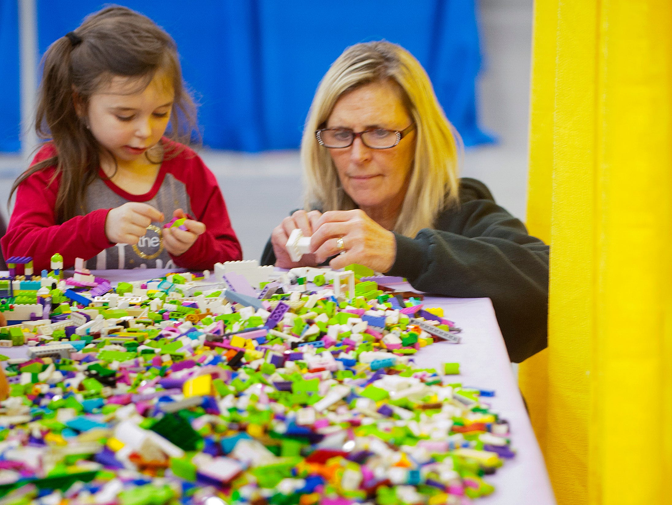 Kaley-Jane Bennett, age 5, of Taylorsville, plays with Legos with her grandmother, Lynn Cubero of Shepherdsvile, at the BrickUniverse Lego Fan Convention at the Kentucky International Convention Center in downtown Louisville.19 January 2019