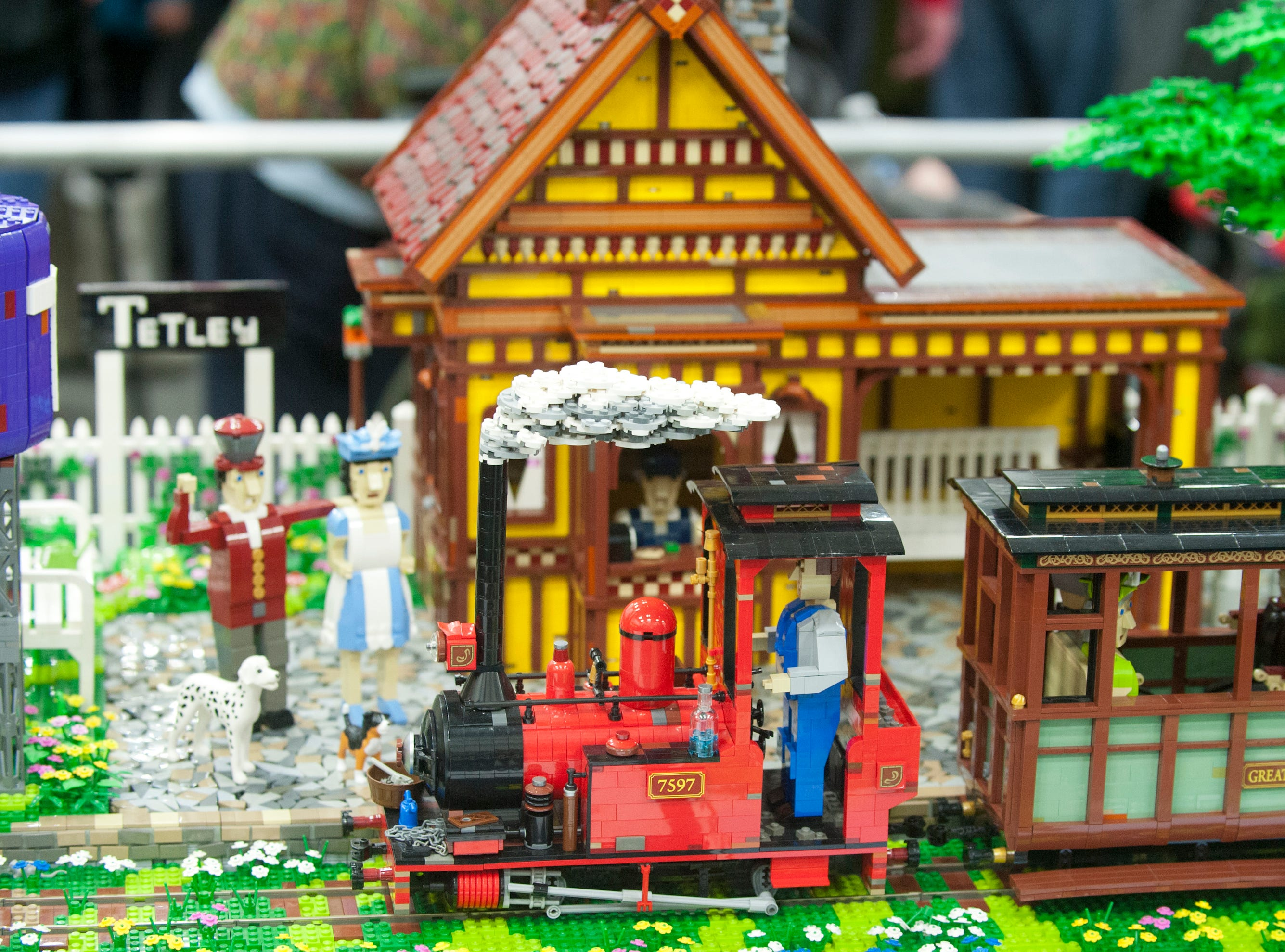 Sunday Afternoon Tea Train to Tetley at Tetly by artist Paul Hetherington shows a smoke-puffing train pulling into the station at Tetley, a village. The train, its engineer and passengers, station and people at the station are all made of Legos. It took Hetherington 16,700 bricks and 170 hours to create the fun scene.19 January 2019