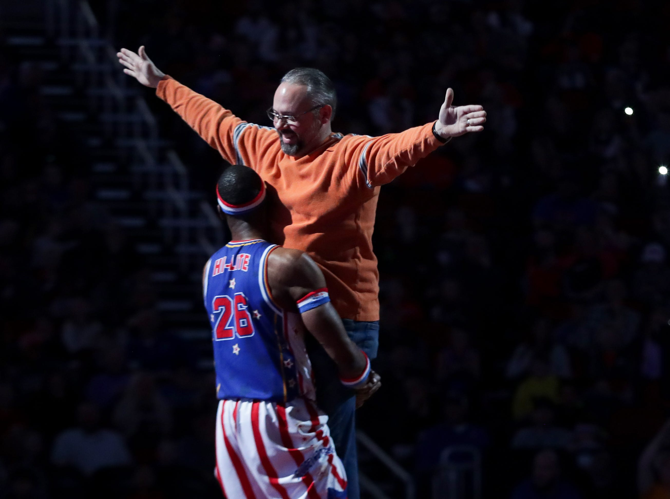 Harlem Globetrotters' Hi-Lite dances with a member of the audience to the Titanic song.  Jan. 19, 2019