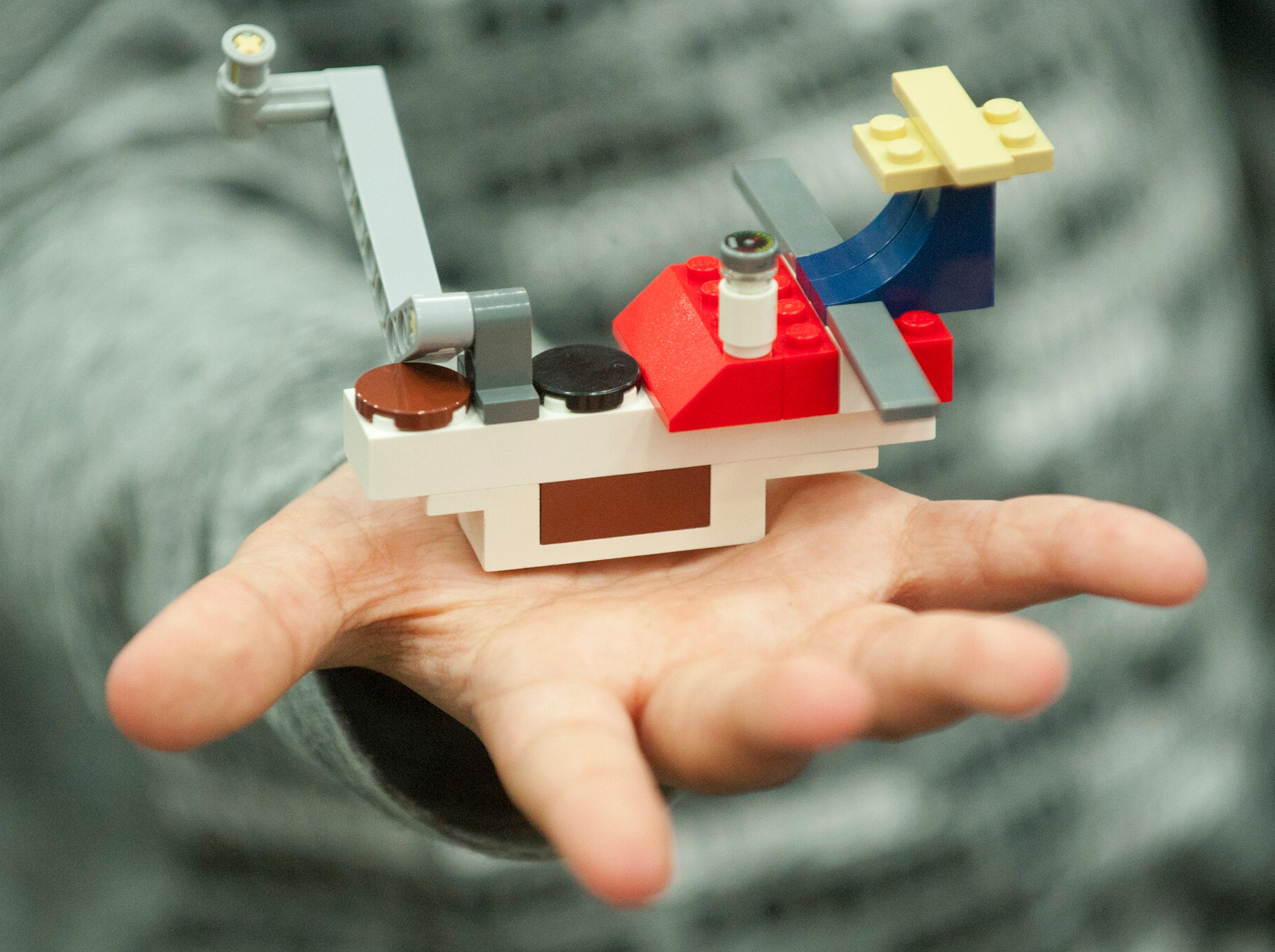 A detail of the winning  Lego building competition Challenge Zone space station held in the palm of the hand of the station's creator, Luke Johnson, age 8, of Buckner.19 January 2019