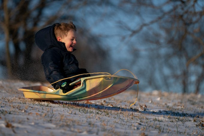 Sven Wilkerson, 4, sleds down a hill in Cherokee Park following a snow storm that dusted Louisville, Ky., Sunday, Jan 20, 2019.