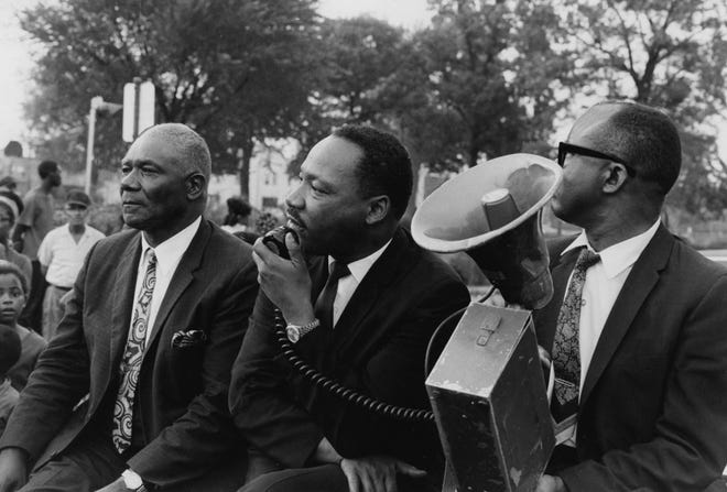 Martin Luther King Jr. waits in August 1967 to speak to housing protesters in Louisville?s South End.Aug. 20, 1967
