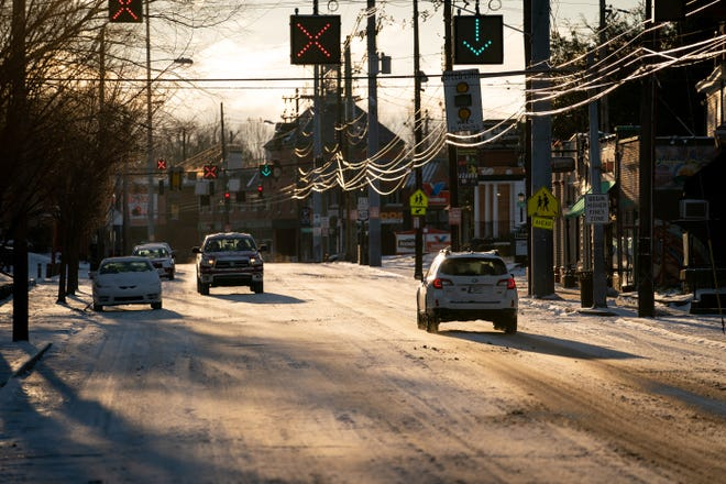 Cars travel on a snow covered Bardstown Road following a snow storm that dusted Louisville, Ky., Sunday, Jan 20, 2019.