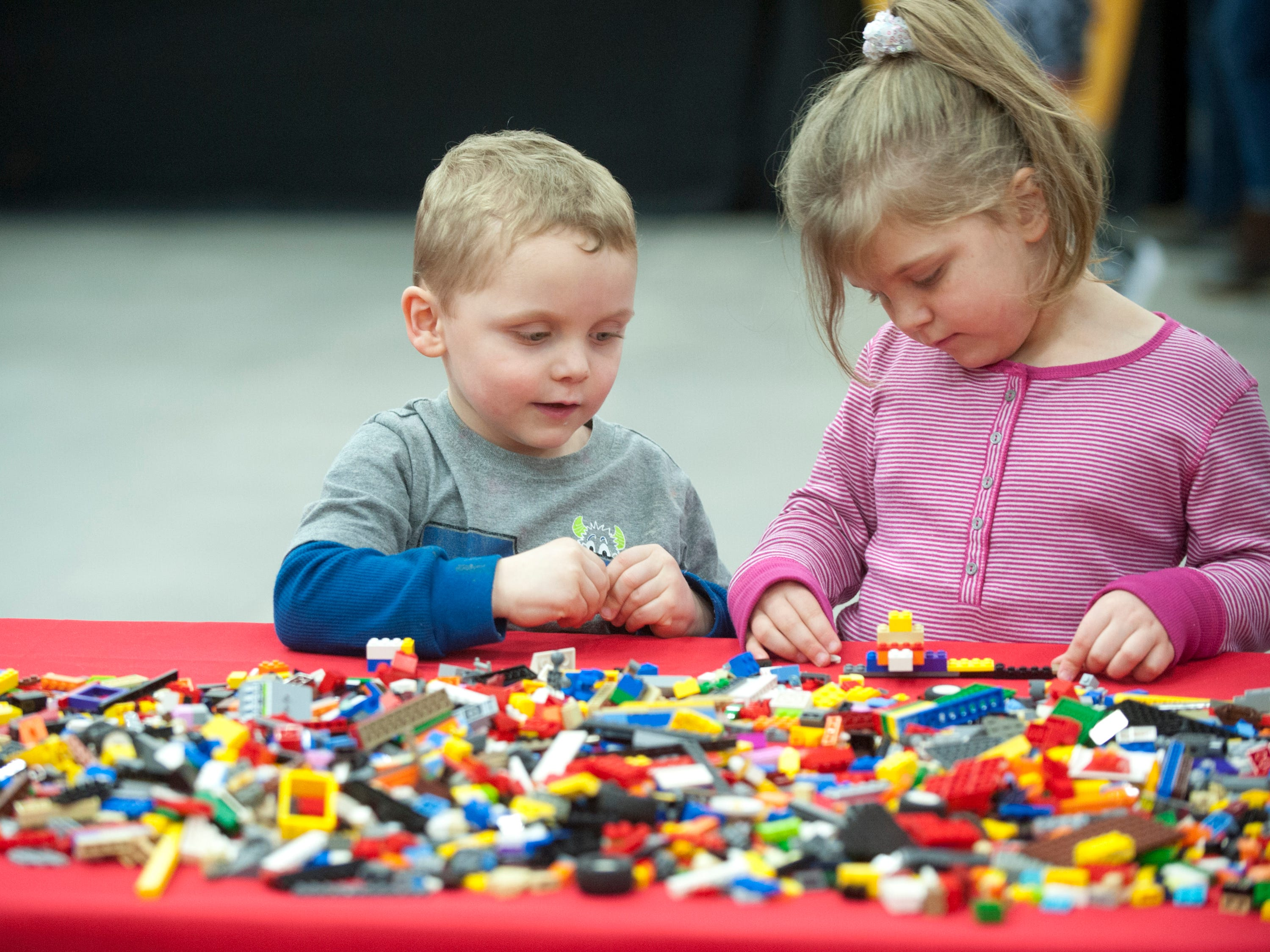"""Timmy Riviello, age 4, and hi sister key, age 5, o Irvington, play with Legos in the Building Zone"""" at the BrickUniverse Lego Fan Convention at the Kentucky International Convention Center in downtown Louisville.19 January 2019"""