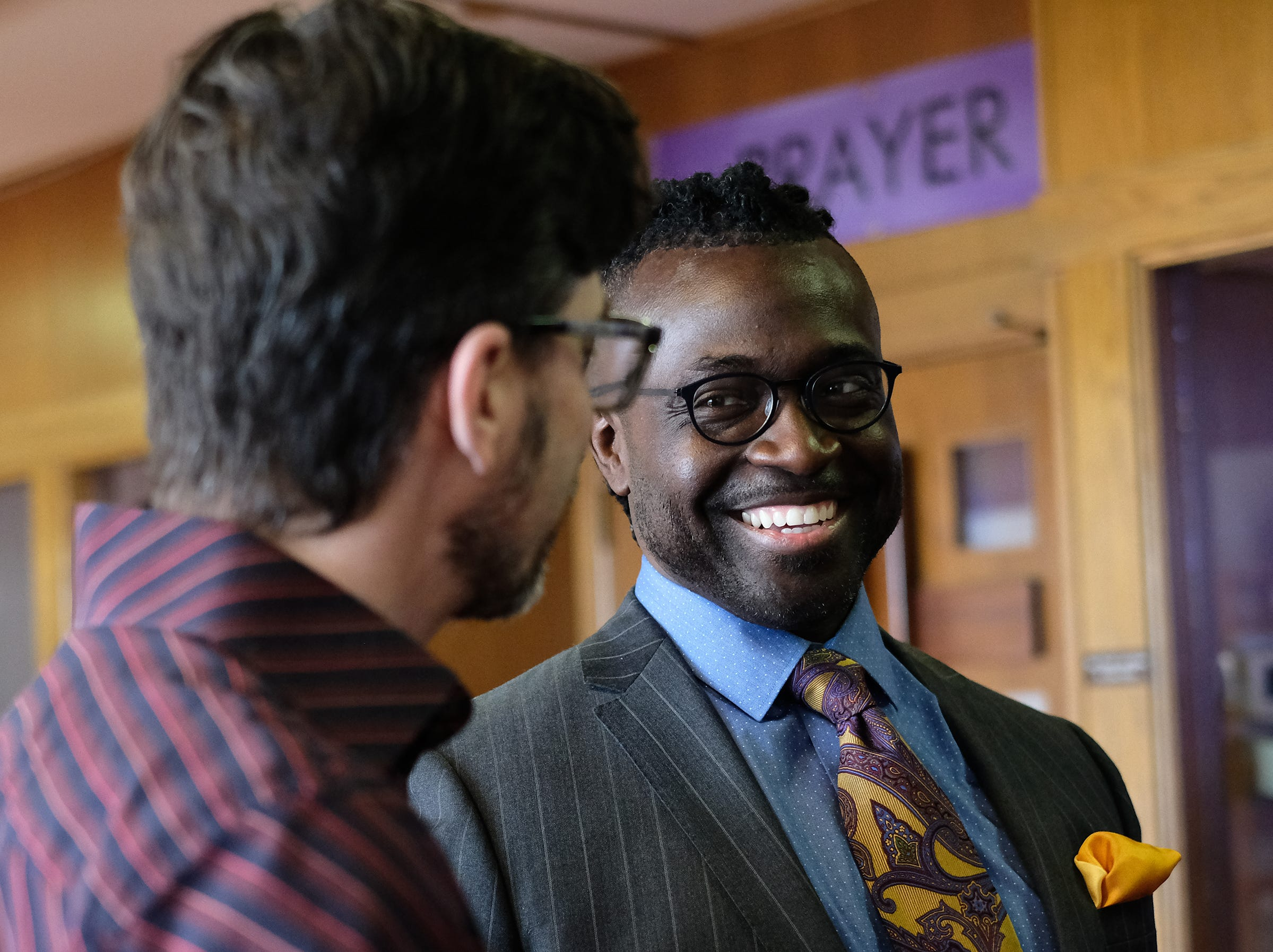 Pastor Sean Holland of Epicenter of Worship Church, right, welcomes and talks to Pastor, Tom Arthur of Sycamore Creek Church before services Sunday, Jan. 20, 2019. The congregation of Sycamore Creek a predominately white congregation joined Epicenter a predominately black congregation, for its celebration of the Rev. Martin Luther King Jr. A luncheon and panel discussion were also part of the event.