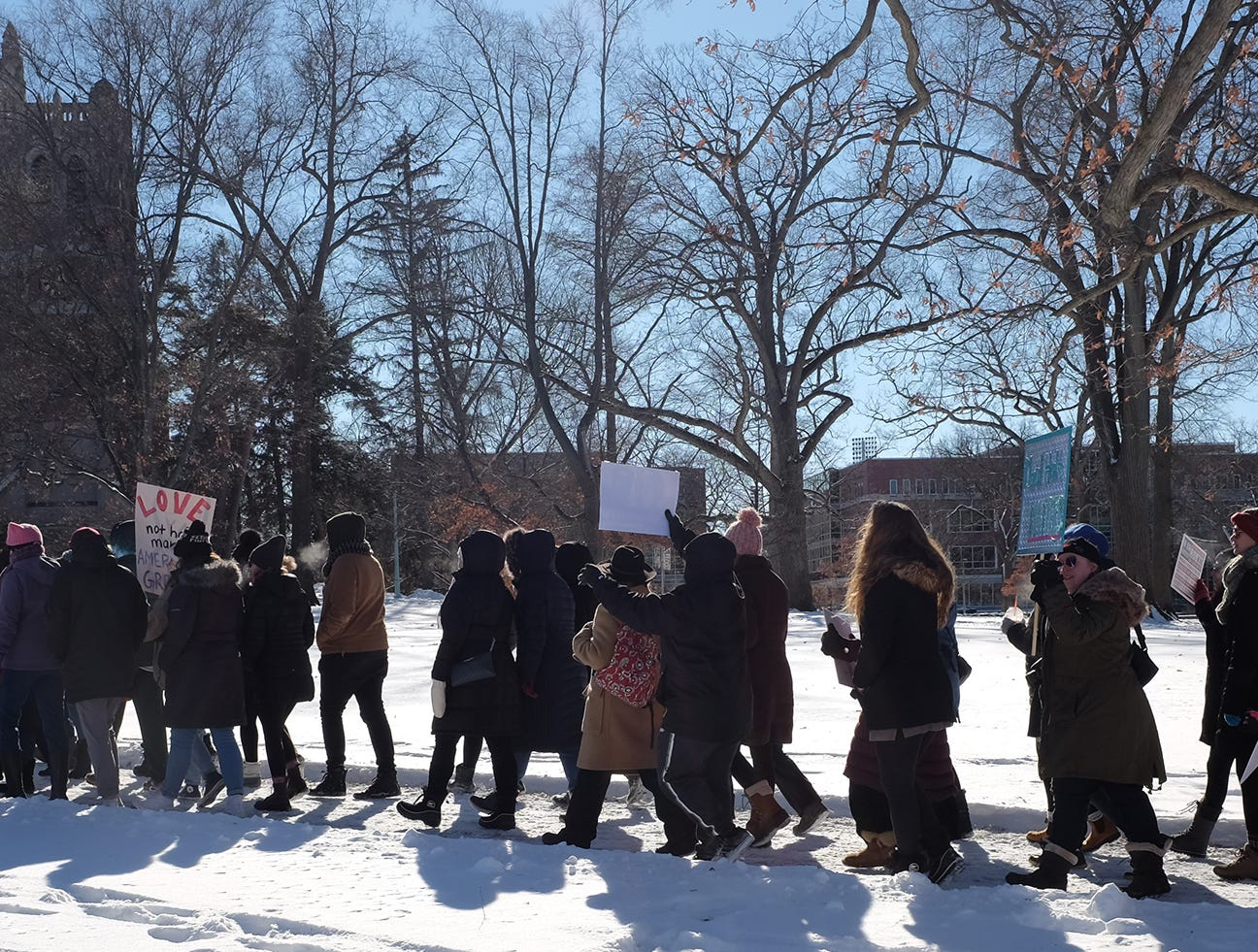 People participating in Lansing's Women's March walk from the Michigan State University Union Building to the Hannah Administration Building Sunday, Jan. 20, 2019.