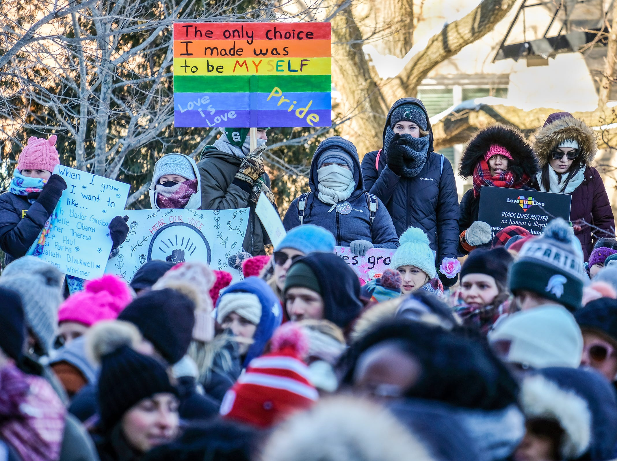 Despite temperatures hovering around 10 degrees and a wind chill well below zero, around 500 people participate in Lansing's Women's March Sunday, Jan. 20, 2019 on the Michigan State Campus.