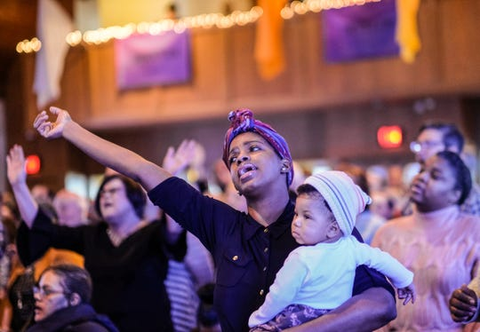Davia Gooden sings with her daughter Naomi, 7 months, at Epicenter of Worship Church during the Martin Luther King services Sunday, Jan. 20, 2019. The church invited the pastor and members of the mostly white congregation of Sycamore Creek Church to the service.
