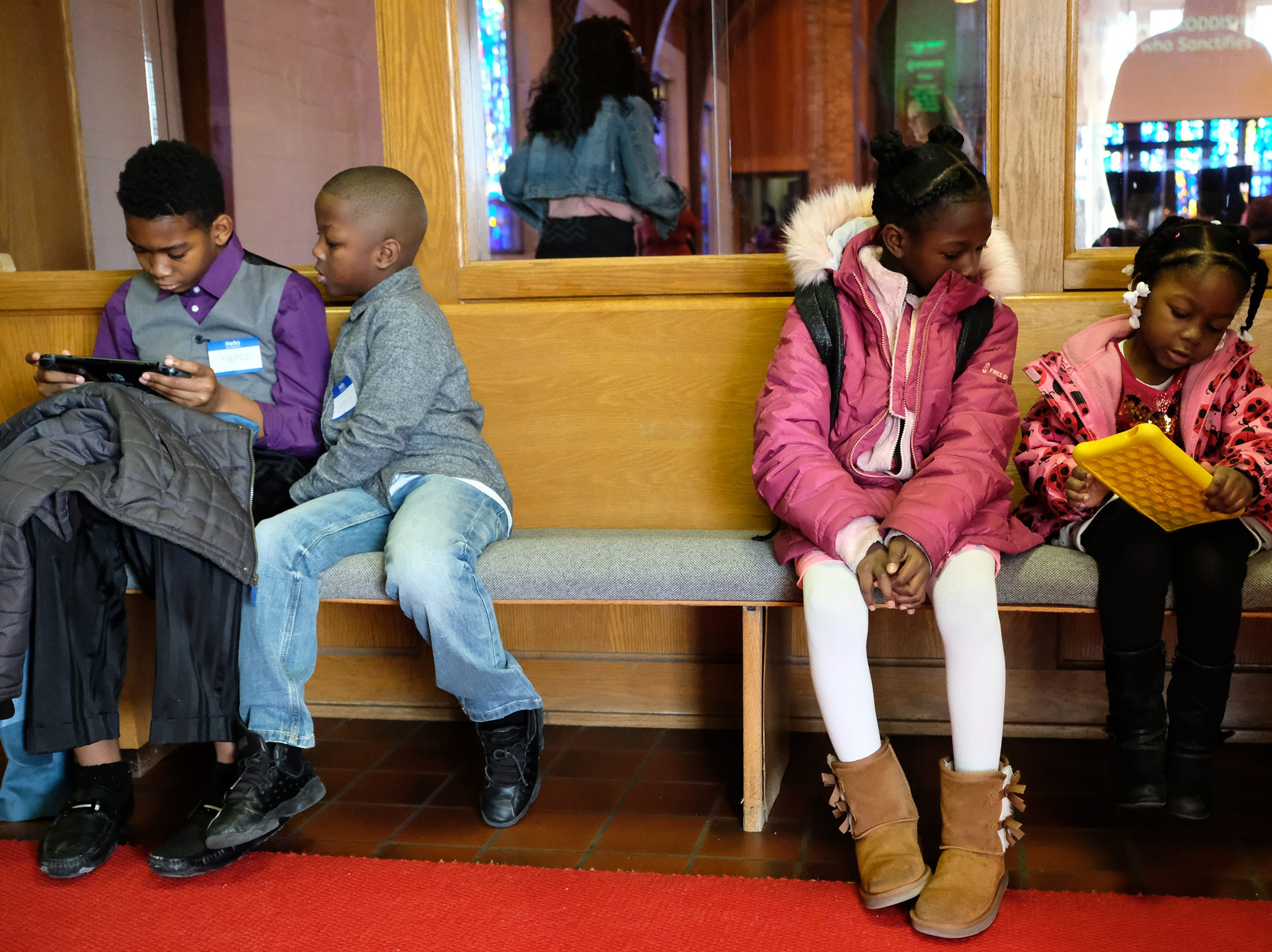 Kids have fun with tablets before services start at Epicenter of Worship Church Sunday, Jan. 20, 2019.