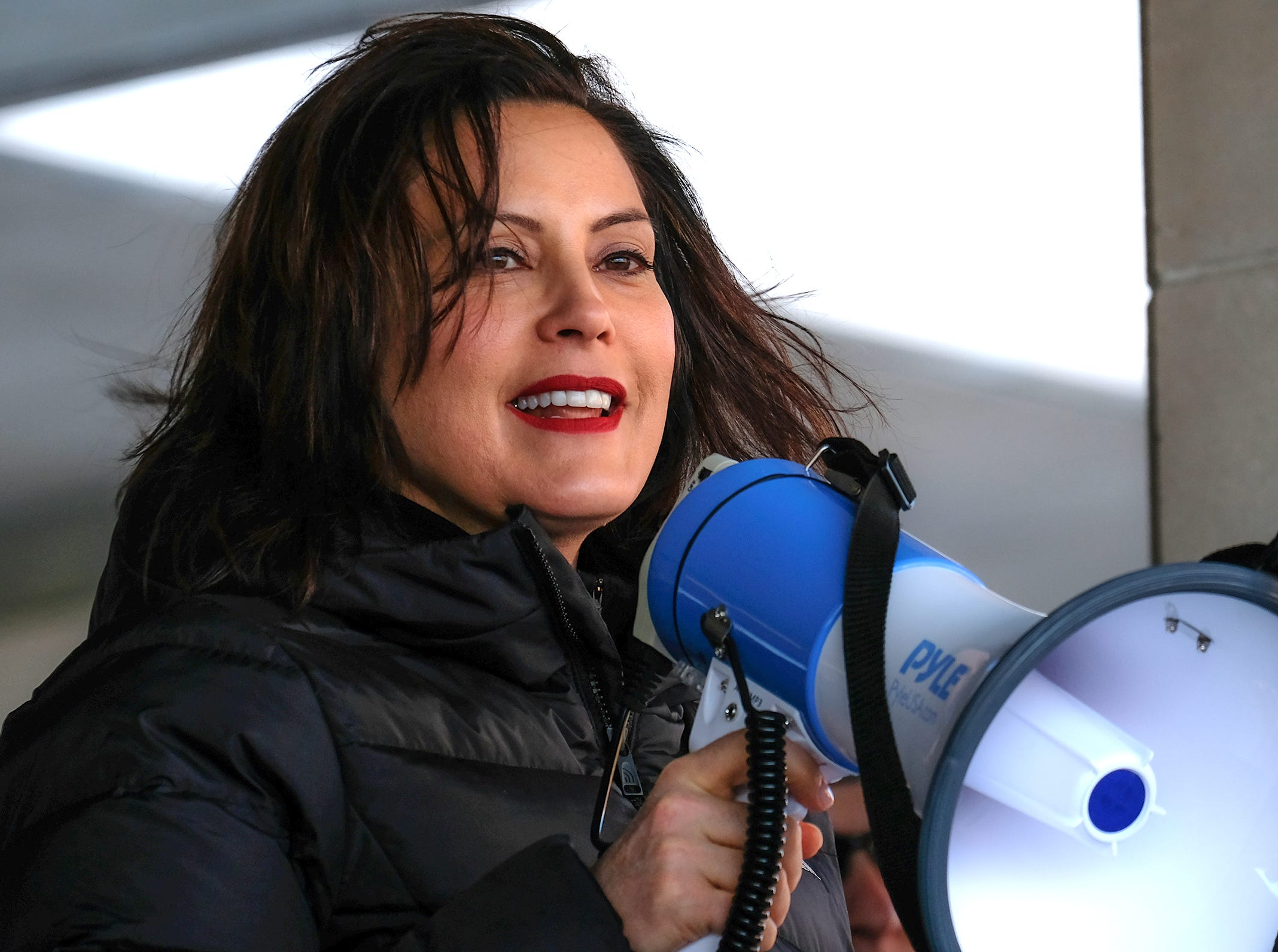 Michigan Governor Gretchen Whitmer speaks to a crowd of around 500 people who braved the frigid weather to participate in Lansing's Women's March Sunday, Jan. 20, 2019.