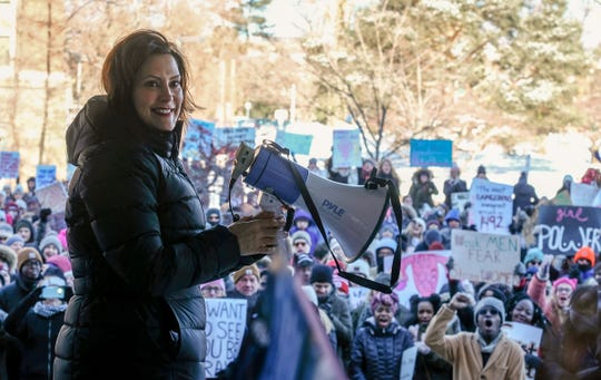 Michigan Governor, Gretchen Whitmer finishes speaking to the crowd of around 500 in during the Lansing's Women's March on the campus of Michigan State University Sunday, Jan. 20, 2019.