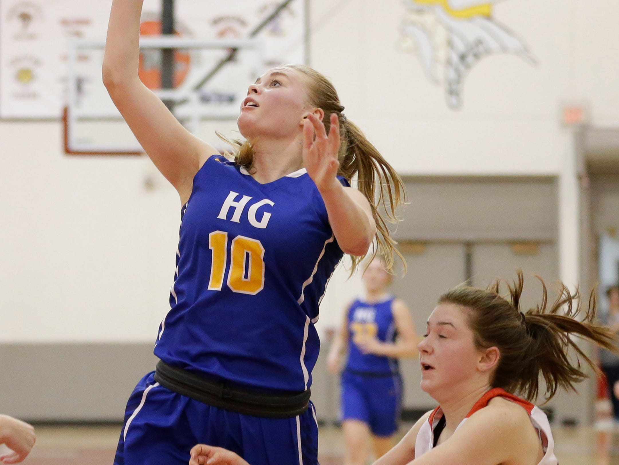 Howards Grove's Leah Parnitzke (10) drives past Valders' Kate Wagner (20) for a layup during a non-conference game at Valders High School Saturday, January 19, 2019, in Valders, Wis. Joshua Clark/USA TODAY NETWORK-Wisconsin