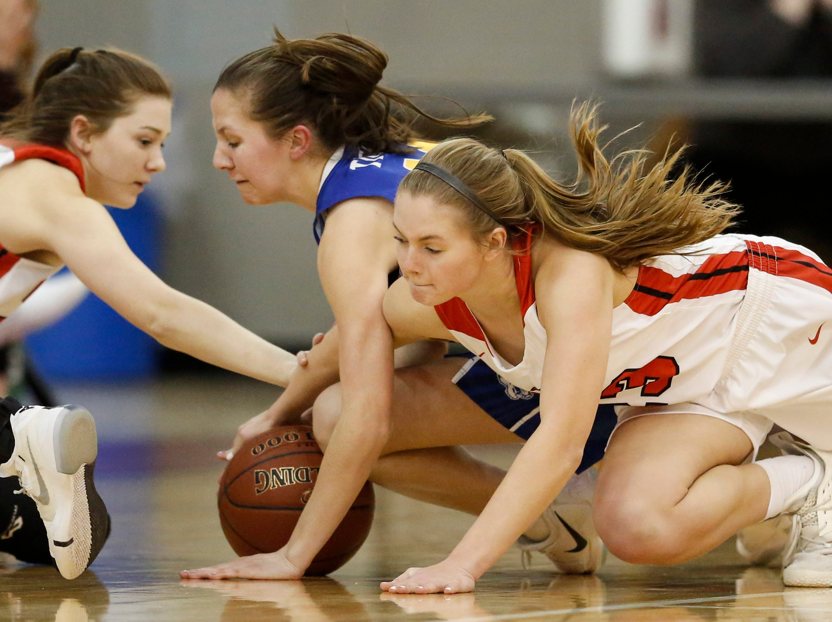 Valders' Madison Sabel (23) battles Howards Grove's Riley Jahnke (14) for a loose ball during a non-conference game at Valders High School Saturday, January 19, 2019, in Valders, Wis. Joshua Clark/USA TODAY NETWORK-Wisconsin