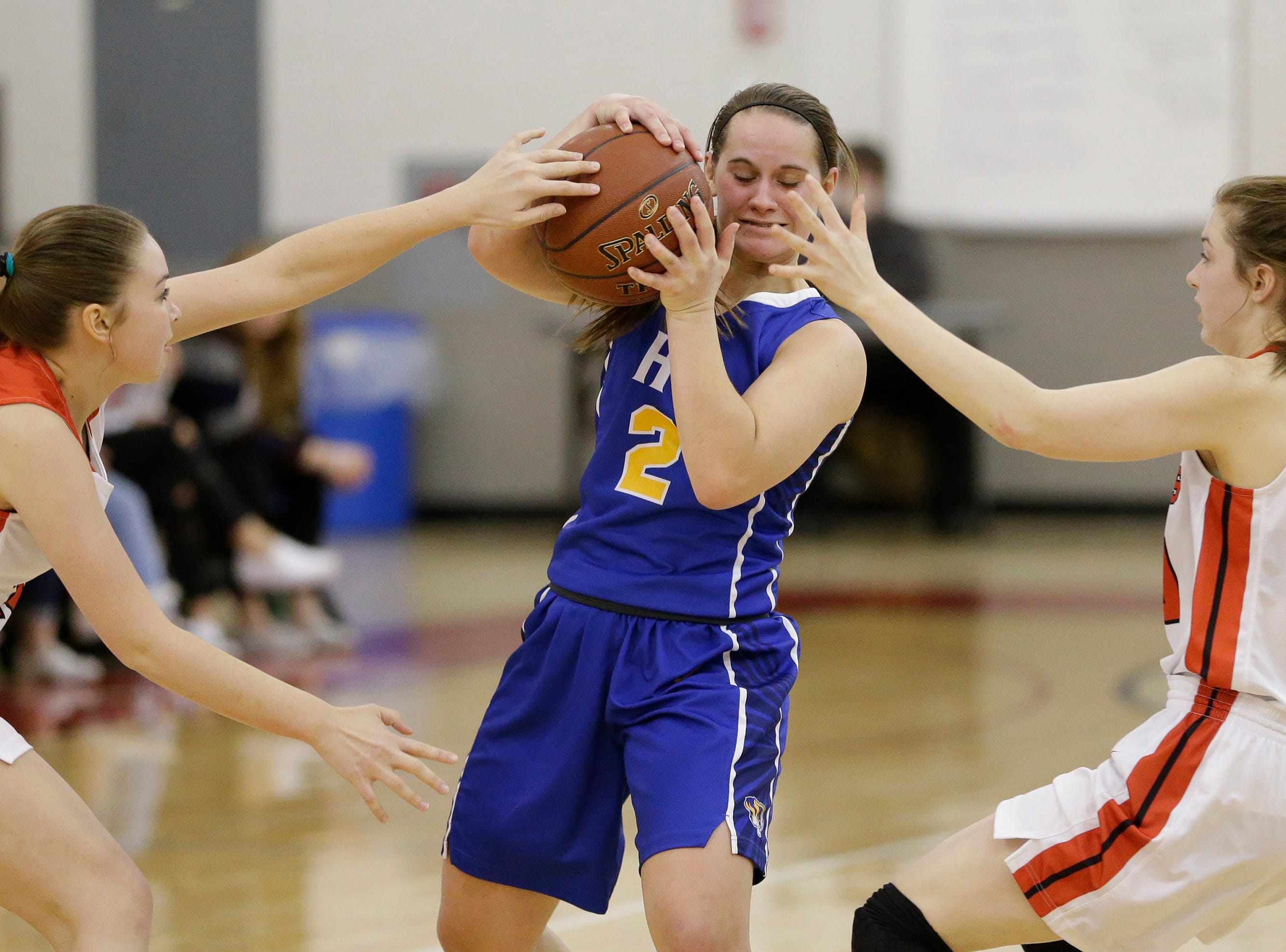 Howards Grove's Zayla Mueller hangs onto the ball as she gets pressure from Valders during a non-conference game at Valders High School Saturday, January 19, 2019, in Valders, Wis. Joshua Clark/USA TODAY NETWORK-Wisconsin