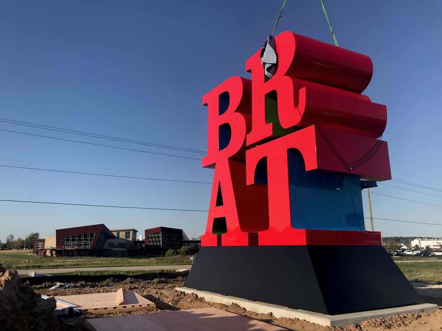 """BRAT,"" believed to be a late work by artist Robert Indiana, being installed in front of Johnsonville Sausage in Sheboygan County."