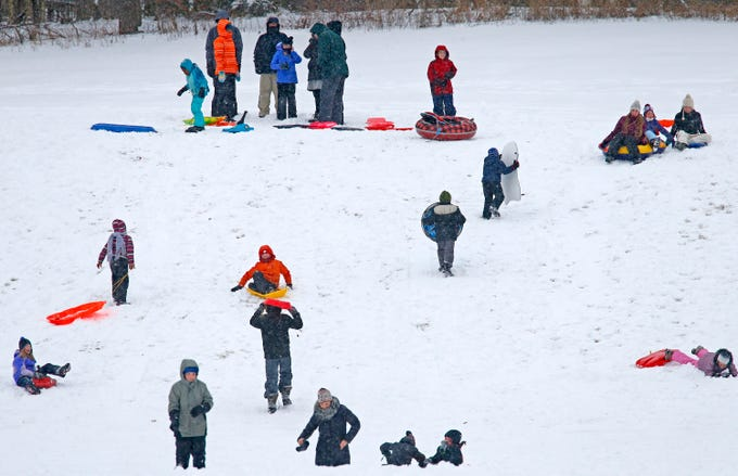Sledders blanket the Wirth Park South hill in Brookfield after the first sledding snow arrived overnight on Jan. 19.