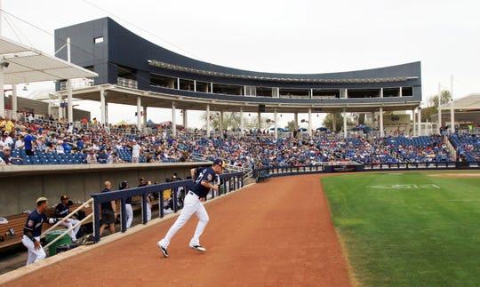 Pitcher Zach Davies leads Milwaukee Brewers onto the field at Maryvale Baseball Park last March for the final home game of the 2018 spring training season. Renovation of the ball park began last spring and will be completed in time for the home opener in February.