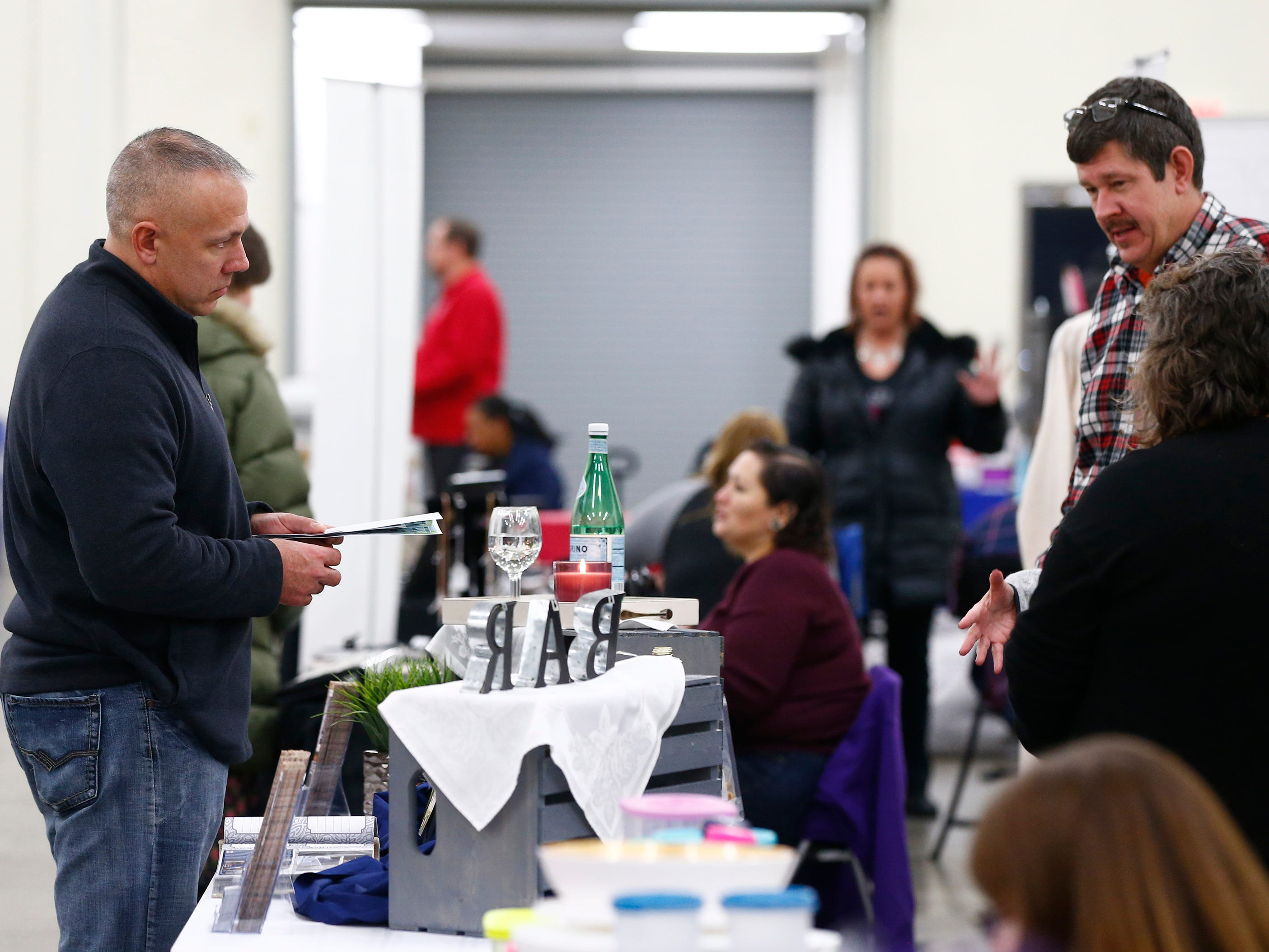 Visitors talk with vendors during a business winter vendor event hosted by Beer Me. Waukee, a beer-inspired Milwaukee apparel brand, at the Waukesha County Expo Center on Jan. 19.