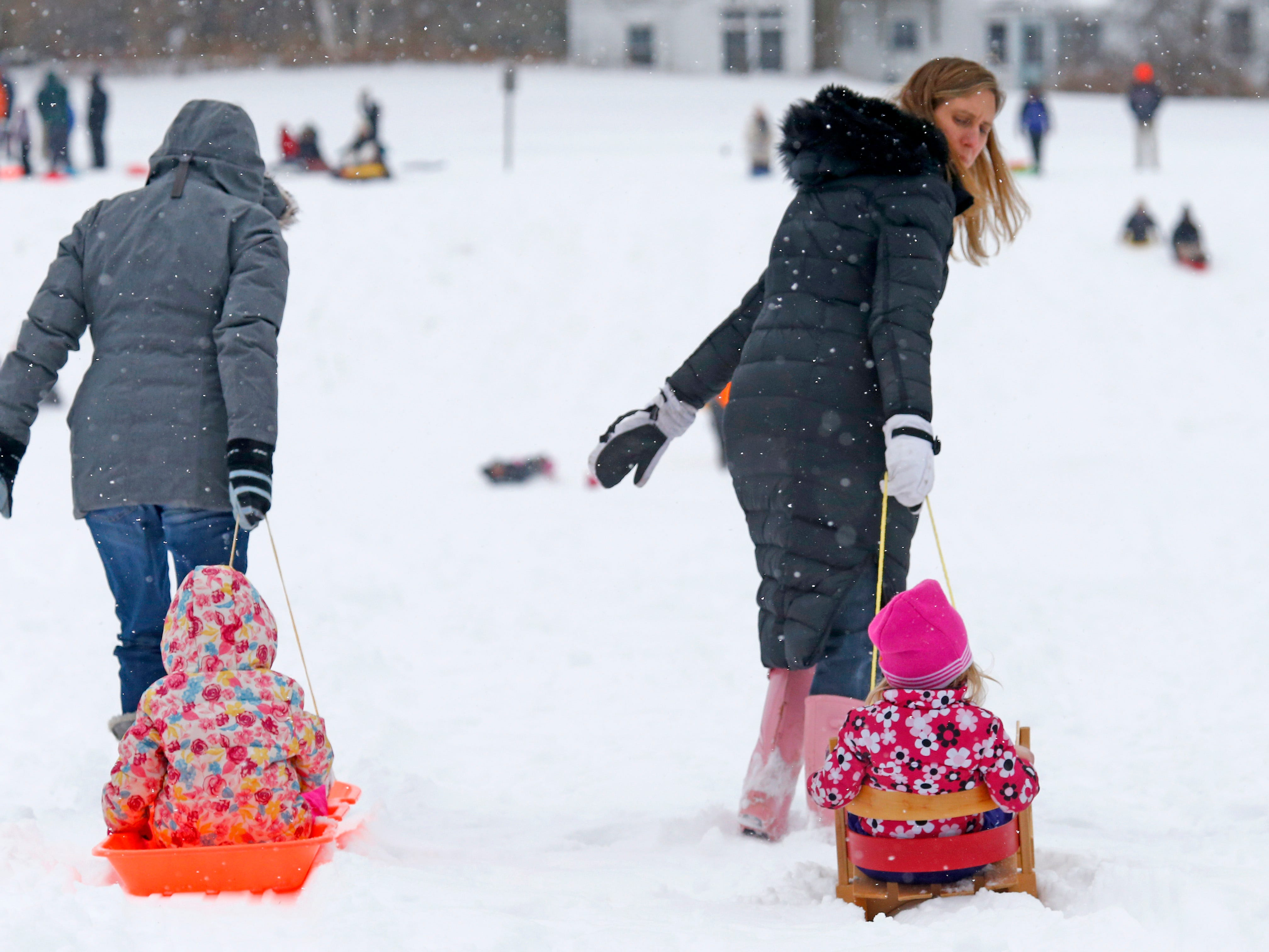 Families head out for sledding on the Wirth Park South hill in Brookfield after the first sledding snow arrived overnight on Jan. 19.