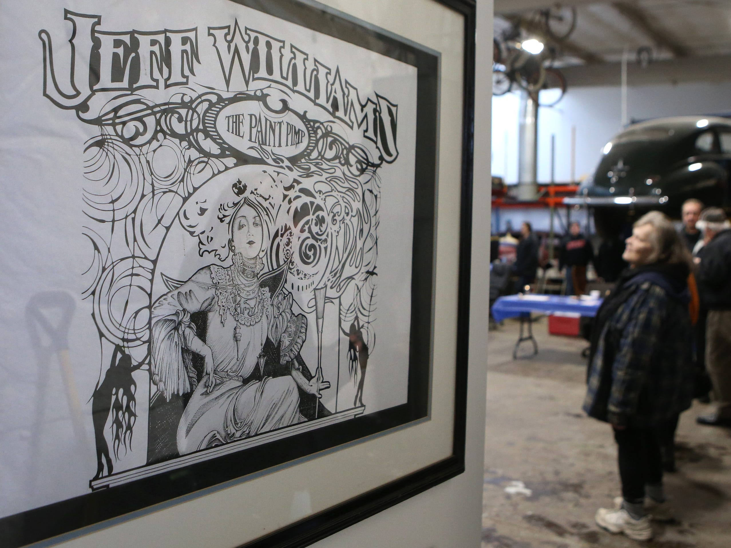 Artwork by Jeff Williams, sign painter and owner of The King of Paint, on display during an open house at the King of Paint shop in St. Francis on Jan. 19.