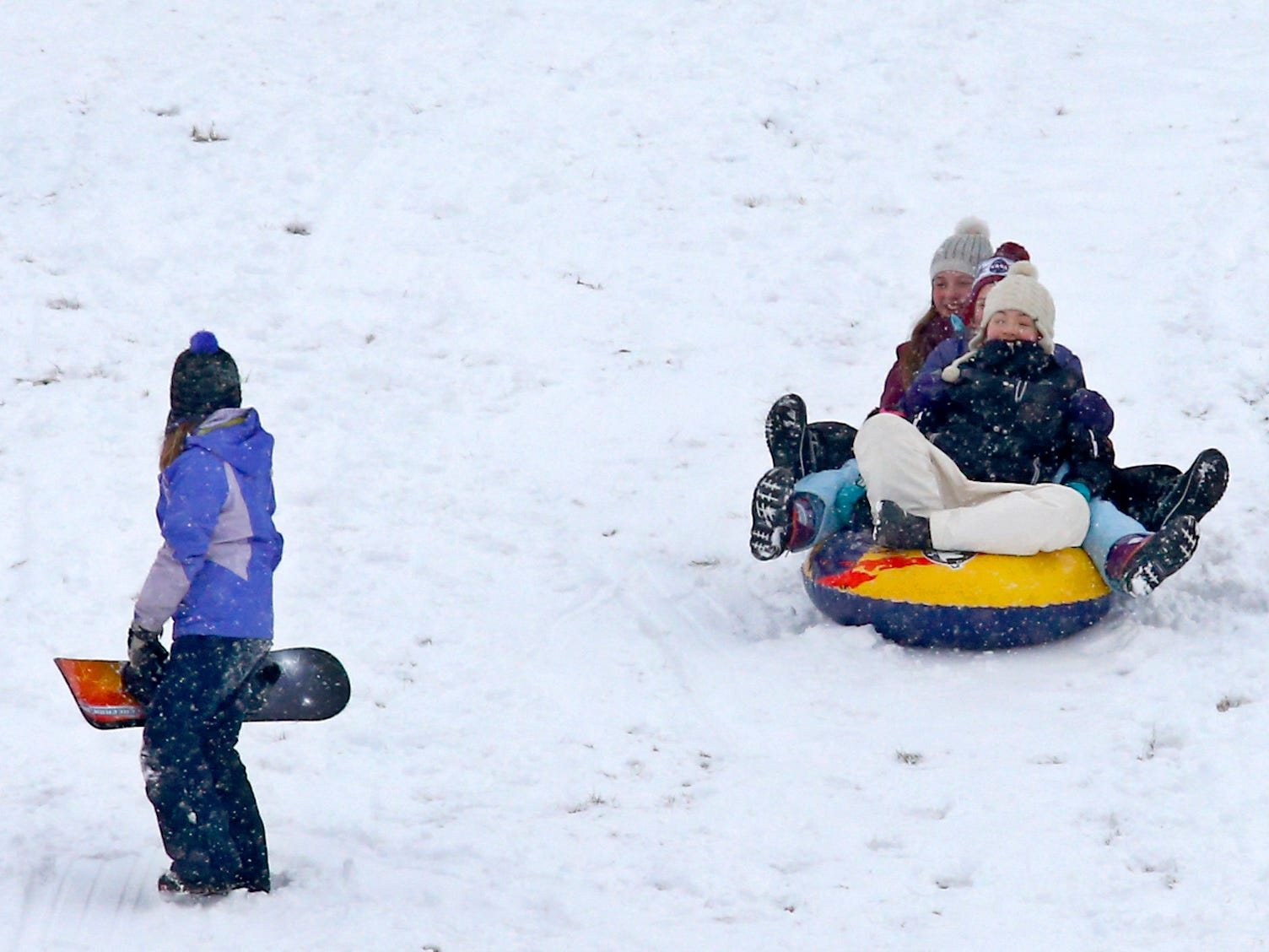 Sledders sail down the Wirth Park South hill in Brookfield after the first sledding snow arrived overnight on Jan. 19.