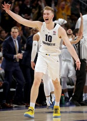 Marquette forward Sam Hauser celebrates a three-point basket late in the Golden Eagle's 79-68 win over Providence on Sunday at Fiserv Forum.