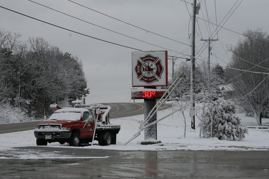 Despite the slushy, windy and cold conditions, several area volunteer firefighters and residents came out Saturday afternoon to commemorate the Henderson Volunteer Fire Department's pumper truck.