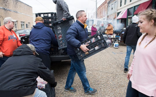 Ryan Friday, owner of Coosa Cleaver, carries some donated bread in Wetumpka, Ala., on Sunday, Jan. 20, 2019. Friday and his staff closed the restaurant for the day to prepare food for first responders and volunteers.
