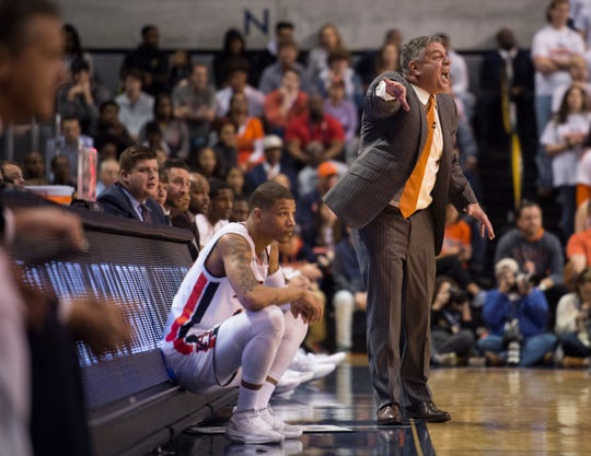 Auburn head coach Bruce Pearl yells at his team from the bench during a game at Auburn Arena.