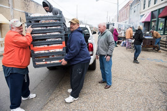 Volunteers deliver donated bread to the Coosa Cleaver restaurant as they make food for first responders and volunteers in Wetumpka, Ala., on Sunday, Jan. 20, 2019.