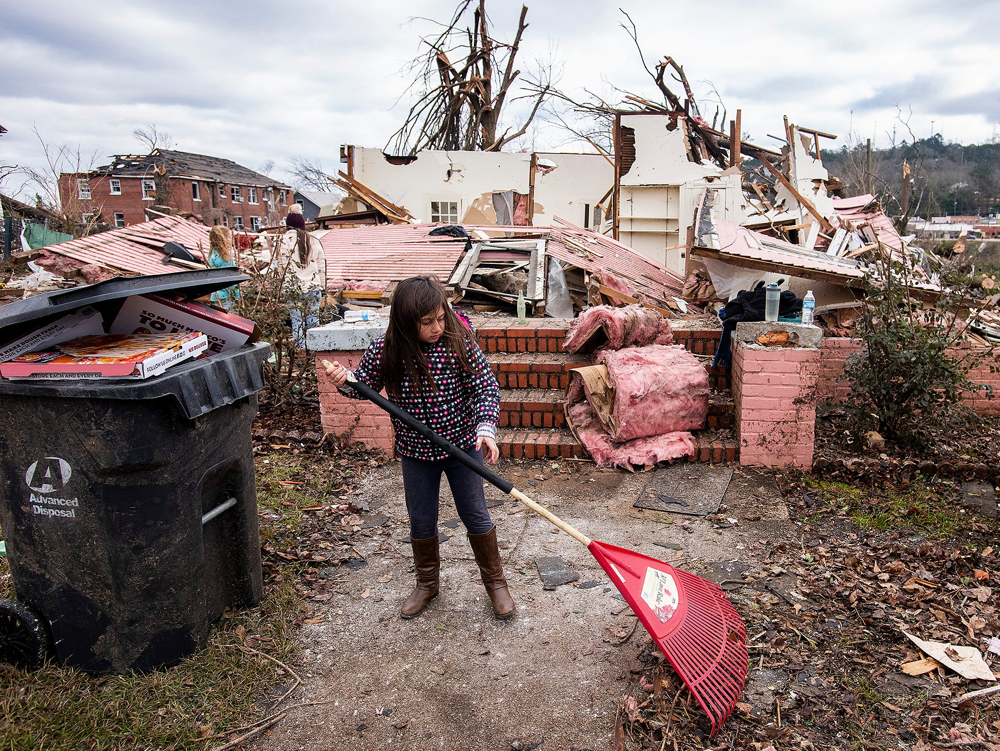 Young volunteer Brantley Bozeman helps clean up debris on Sunday January 20, 2019, after a tornado hit Wetumpka, Ala., on Saturday afternoon.