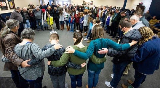The First Presbyterian congregation prays together as they hold service at Depot Players in Wetumpka, Ala., on Sunday January 20, 2019.