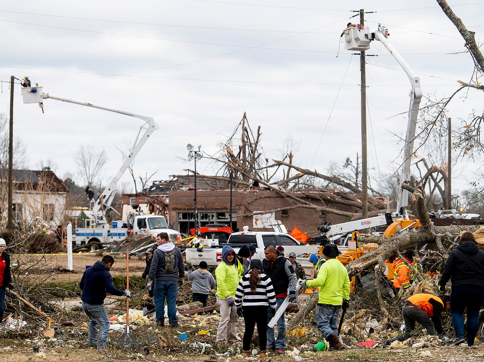 Young volunteers clean up debris on Sunday January 20, 2019, after a tornado hit Wetumpka, Ala., on Saturday afternoon.