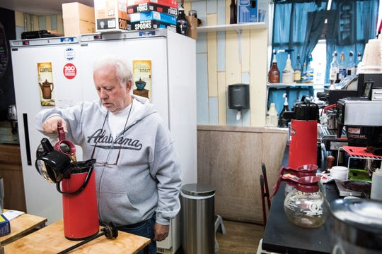 Johnny Oats owner of River Perk makes coffee in his shop to pass out for free in Wetumpka, Ala., on Sunday, Jan. 20, 2019.