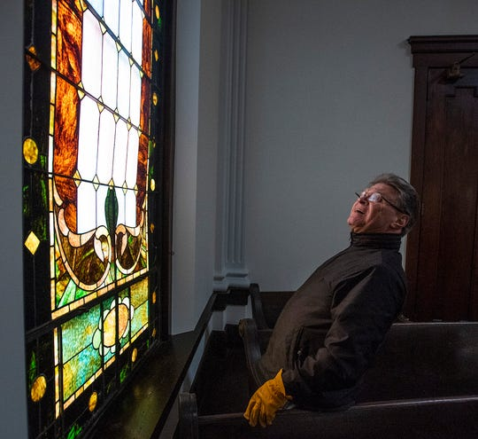 Wetumpka First Baptist Church pastor James Troglen checks stained glass windows for damage in the church's old sanctuary on Sunday January 20, 2019, after a tornado hit Wetumpka, Ala., on Saturday afternoon.