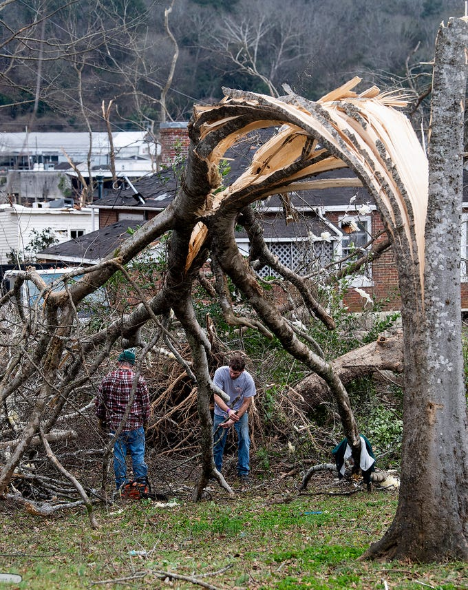 Workers clean up debris on Sunday January 20, 2019, after a tornado hit Wetumpka, Ala., on Saturday afternoon.