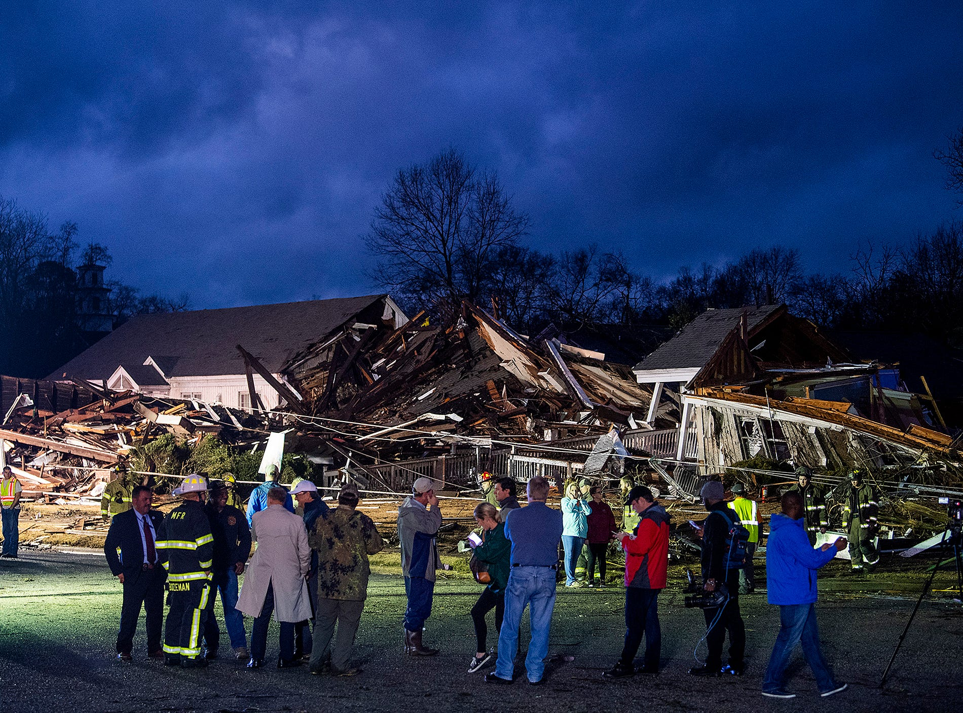 Night falls as damage from a tornado touchdown in Wetumpka, Ala., on Saturday afternoon January 19, 2019 is lit by emergency lighting.