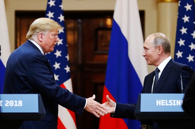 FILE In this file photo taken on Monday, July 16, 2018, U.S. President Donald Trump shakes hand with Russian President Vladimir Putin at the end of the press conference after their meeting at the Presidential Palace in Helsinki, Finland.  The pullout of U.S. troops from Syria ordered by President Donald Trump could further bolster Moscow's clout in Syria, but it may also destabilise Russia's standing in the region. (AP Photo/Alexander Zemlianichenko, File)