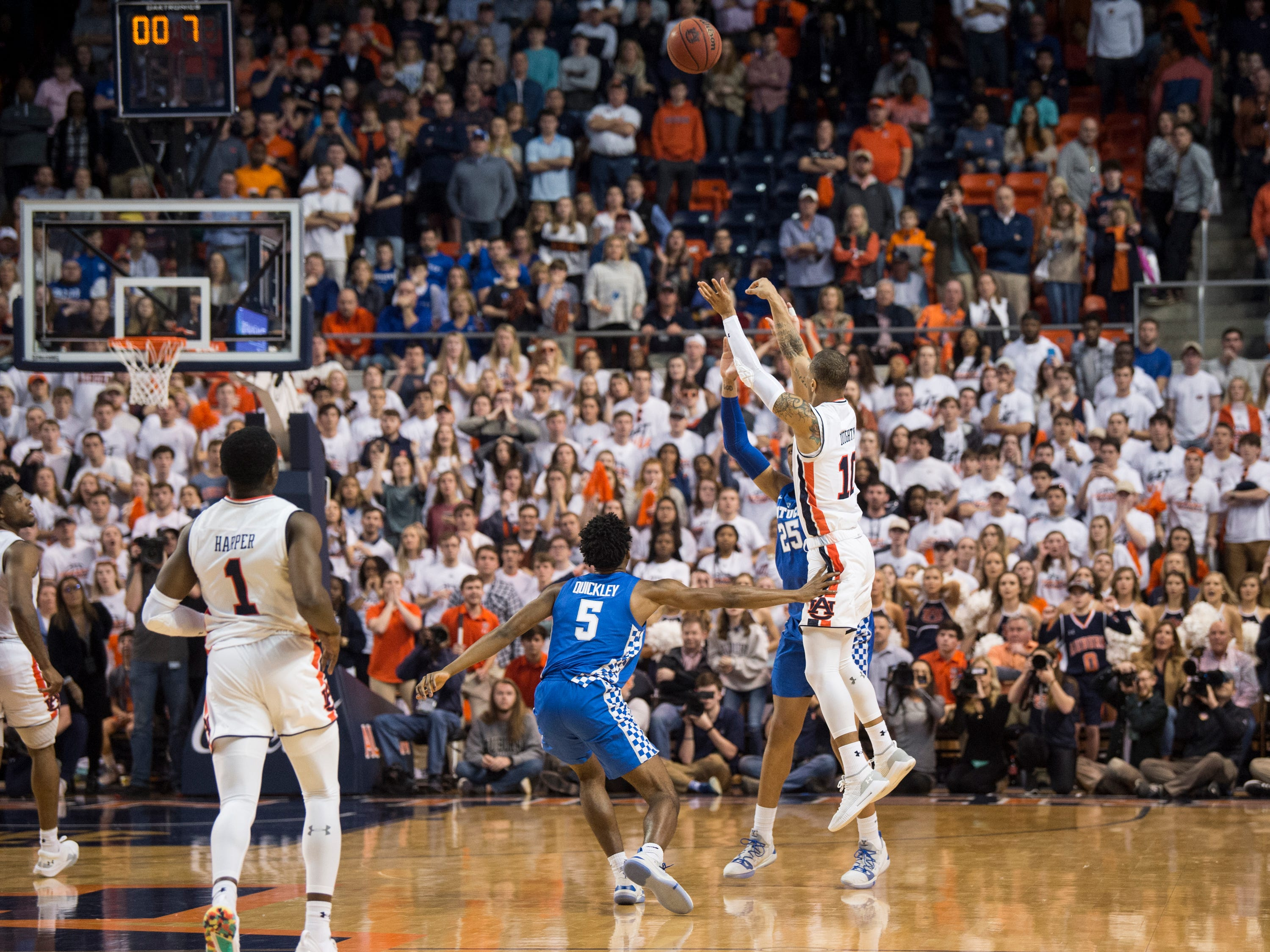 Auburn guard Samir Doughty (10) throws up a desperation half court shot in the final play of the game at Auburn Arena in Auburn, Ala., on Saturday, Jan. 19, 2019. Kentucky defeats Auburn 82-80.