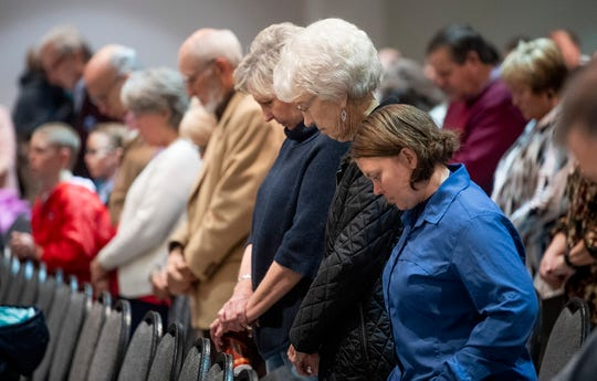 The First Baptist congregation holds a service at Civic Center in Wetumpka, Ala., on Sunday January 20, 2019. Their church was damaged during Saturday's storm.