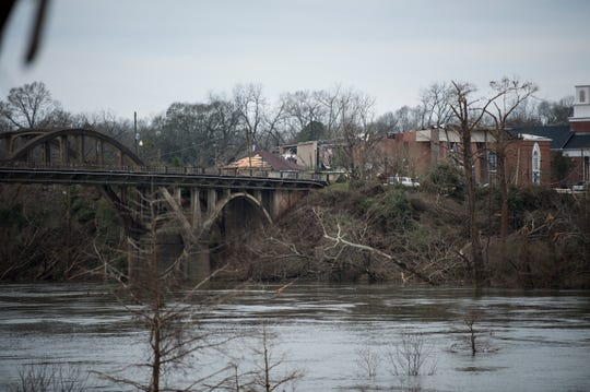 Tornado damage can be seen across the Coosa River in Wetumpka, Ala., on Sunday, Jan. 20, 2019.